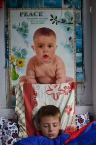 Sick boy, with weird baby poster
